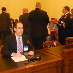 "NJPCAC Board Member Dr. Eric Seaman prepares for testimony before the Senate Health Committee on a resolution declaring June ""Men's Health Awareness Month."""